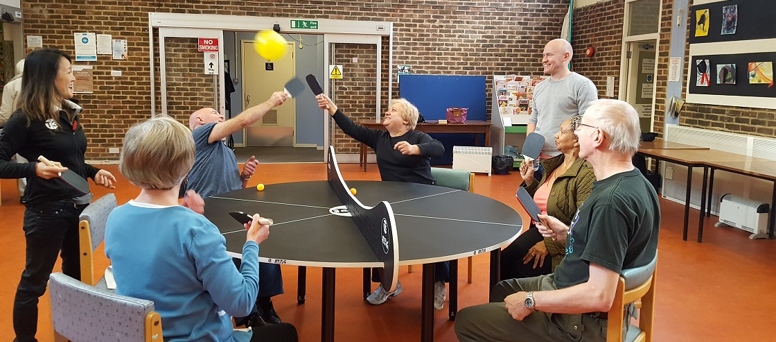 Volunteers at Age UK Islington, Drovers Centre playing T3 Ping Pong
